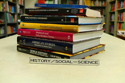 Picture of history and social-science textbooks.