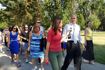 Superintendent Tom Torlakson walking with staff in Capitol Park.