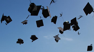 Graduation hats thrown in the air